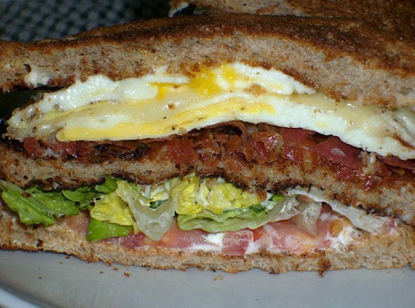 egg, bacon, lettuce, tomatoe and cheese on whole wheat