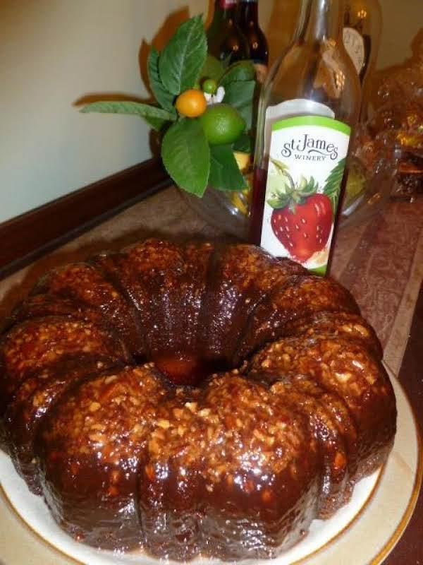 This Strawberry Wine Cake Is One Of The Moistest Cakes You'll Ever Eat!  The Combination Of Strawberry Wine And Strawberry Jam Gives The Cake A Nice Subtle Berry Flavor, And The Glaze That Permeates The Cake Is The Gilding On The Lily! Enjoy!!