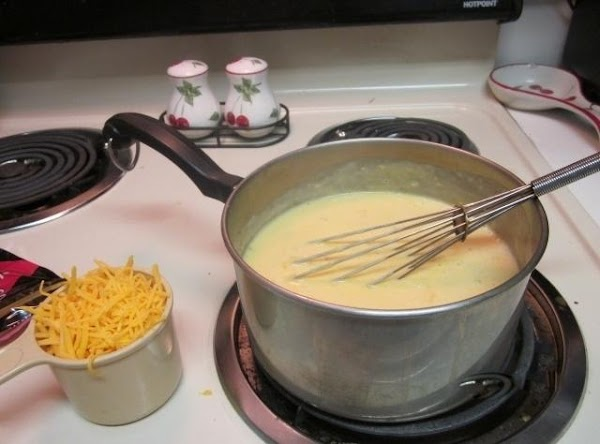 In medium saucepan, heat soup and remaining ingredients, except cheese, until bubbly, stirring occasionally.