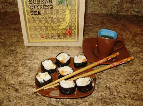 Veggie And Rice Sushi With Korean Ginseng Tea Is A Nice Afternoon Snack.