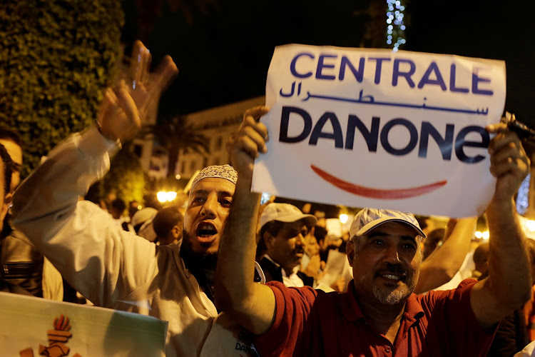 Workers of the Centrale Danone company protest against the boycott of the brand, in front of the parliament in Rabat.