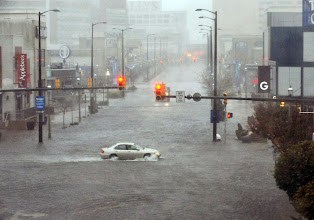 Photo: Flooding and high winds arrive along North Michigan Avenue in Atlantic City, N.J., Monday Oct. 29, 2012. Hurricane Sandy continued on its path Monday, as the storm forced the shutdown of mass transit, schools and financial markets, sending coastal residents fleeing, and threatening a dangerous mix of high winds and soaking rain. (AP Photo/The Press of Atlantic City, Michael Ein) MANDATORY CREDIT