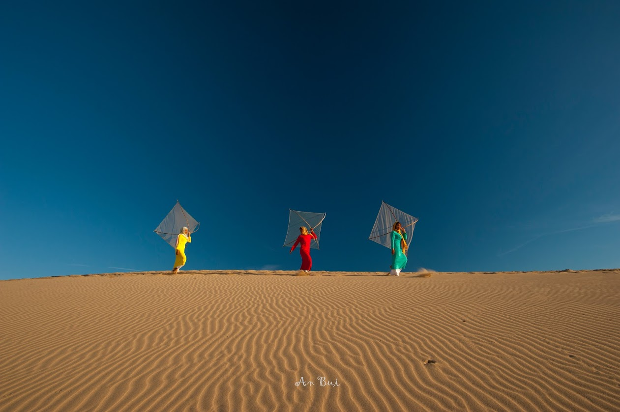 Photo shooting with model in Nam Cuong sand dunes at sunrise