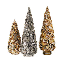 Photo: MARGARET LARKIN Exclusively ours. Assorted holiday trees handmade using vintage costume jewelry. 7″ $450, 12″ $750, 18″ $1250. USA. Seventh Floor. 212 872 2686