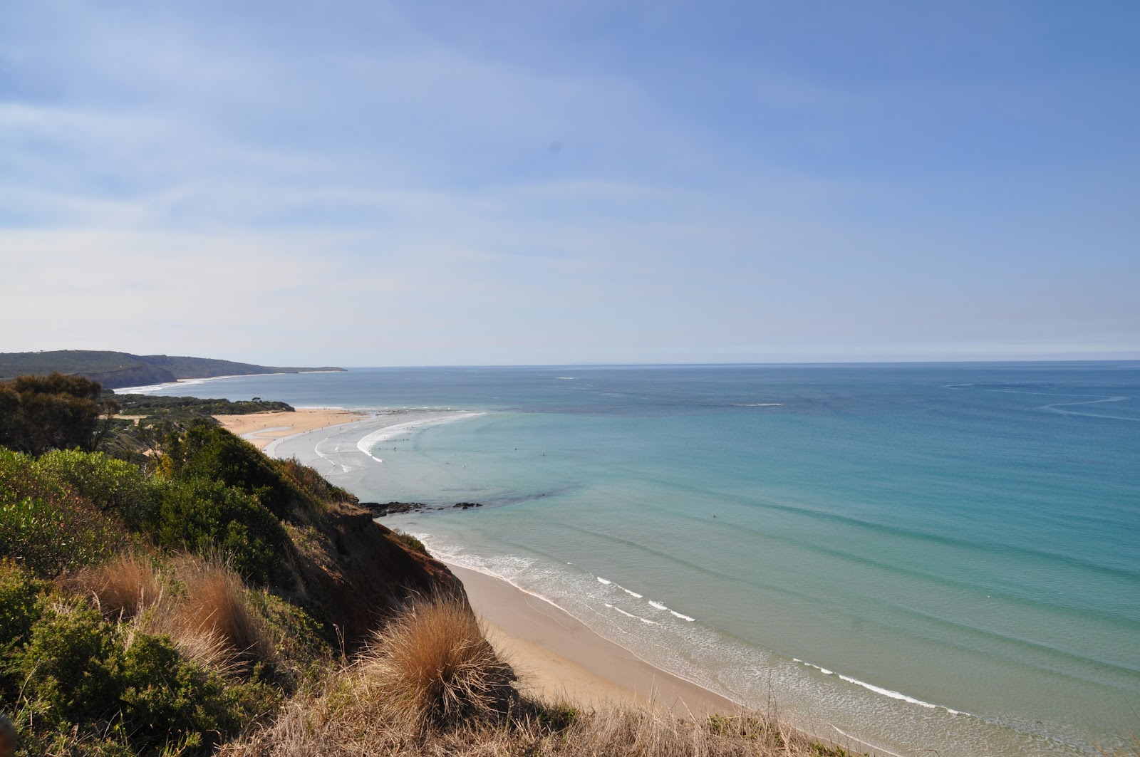 torquay long sandy beach bright blue calm ocean natural beauty of australia. See it from the Great Ocean road during this Australia road trip itinerary around Victoria.