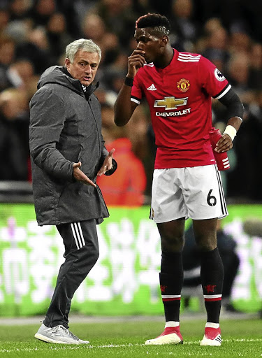 Field coaching: Manchester United manager Jose Mourinho gives Paul Pogba instructions during the recent match against Tottenham. Picture: GETTY IMAGES