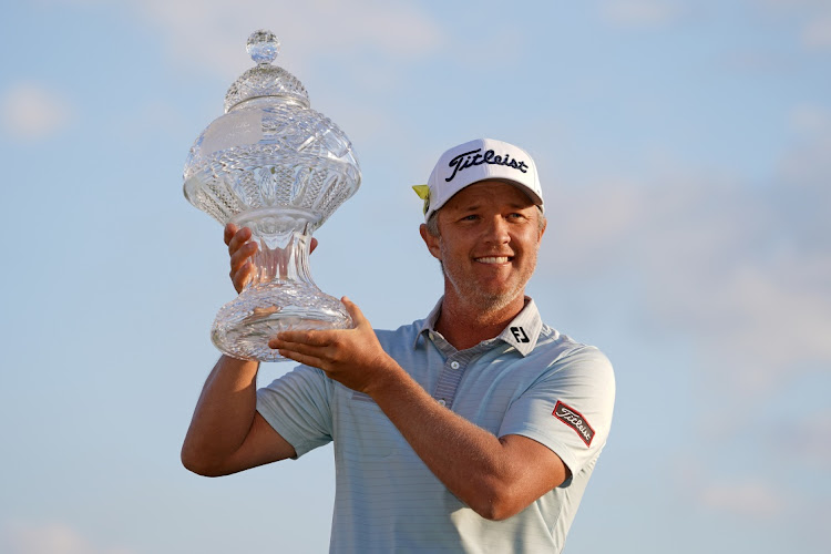 Matt Jones celebrates with the trophy after winning the Honda Classic golf tournament at the PGA National in Florida, the US, March 21 2021. Picture: JASEN VINLOVE/USA TODAY SPORT
