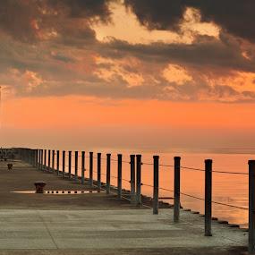 Sunrise over the pier by Brad Kalpin - Landscapes Waterscapes ( water, clouds, orange, waterscape, beauty, scenic, landscape, sun, leading lines, horizon line, peace, pier, sunrise, walk way, light, calm. panorama, photoshop )