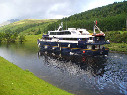 Lord_of_the_Glens.jpg - The Lord of the Glens sails on the Caledonian Canal, near the Laggan Swing Bridge in Scotland.