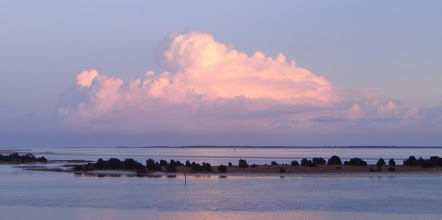 Photo: Sunset's reflected light on clouds