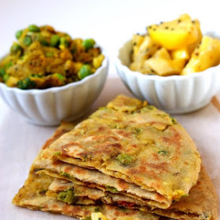 Spiced Potatoes and Peas Stuffed Flat Bread with Preserved Lemons.