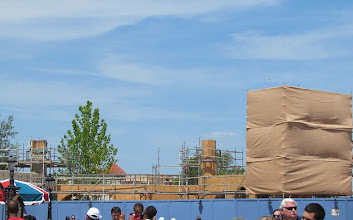 Photo: Work on the wall that will separate old Fantasyland from the new continues with some plywood being added