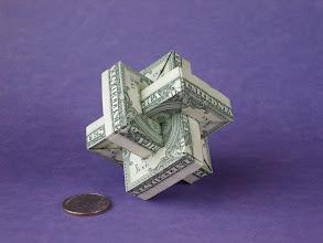 Photo: Model: Umulius Rectangulum;  Creator: Thoki Yenn;  Folder: William Sattler;  6 dollars, 2 for each interlocked ring;  Source: The Clouds of Thoki Yenn http://theory.lcs.mit.edu/~edemaine/thok/umulius.html
