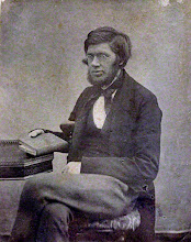 """Photo: Alfred Russel Wallace by Unknown photographer calotype. NPG states that this photo was taken """"1847-1849"""", but it is more likely dated 1853-54. Image size 5 5/8 in. x 4 3/8 in. (143 mm x 112 mm). Given by W.G. and Violet Wallace, 1916 Photographs Collection NPG x5109 © National Portrait Gallery, London Licensed under Creative Commons Attribution-NonCommercial-NoDerivs 3.0 Unported  (http://creativecommons.org/licenses/by-nc-nd/3.0/)"""