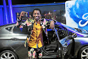 Luyolo  Yiba with the car he won after being named Idols SA winner at  Big Top Arena in Carnival City./Veli Nhlapo