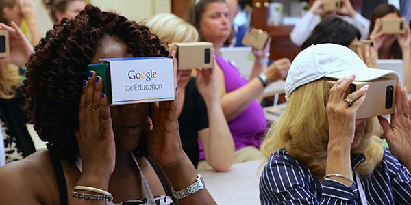 People using Google Cardboard VR viewers