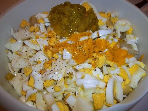 In a large bowl, add cubed potatoes, onion, eggs, salt, pepper, mustard and relish....