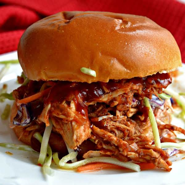 Mouthwatering Good Pulled Chicken Made Easy With Six Ingredients In The Crock Pot.  Serve On Toasted Buns With Coleslaw Or For A Lower Carb Version Simply Add The Slaw To A Layer Of Pulled Chicken.