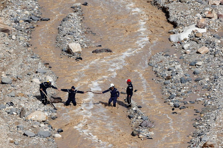 Civil defence members look for survivors after rain storms unleashed flash floods, near the Dead Sea, Jordan, on October 26 2018. Picture: REUTERS/MUHAMMAD HAMED