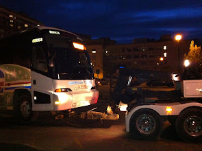 """Photo: A bus that said """"chartered"""" on the front display being towed. Must be one hell of a tour. ;-)"""