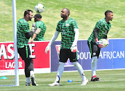 Bafana Bafana goalkeepers Darren Keet (L), Ronwen Williams (R) and Itumeleng Khune share a light moment during a training session.