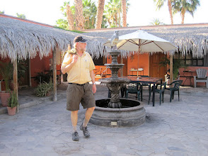 Photo: Bill walking across the patio at the pleasant Iguana Inn where we stayed in Loreto.  We paid about $60/night for our room.
