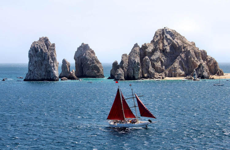 Sailing near the granite rock formations that extend to Land's End in Cabo San Lucas, Mexico.