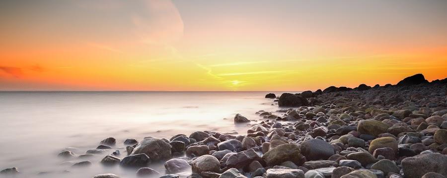 Stone beach by Kim Borup Matzen - Landscapes Beaches ( water, blurred, waterscape, sunset, stone, denmark, beach )