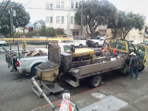 Photo: San Francisco Department of Public Works employees prepare to pump concrete uphill through hose to cement erosion-control barrier posts into place on the final sections of terraced erosion-control barriers on October 10, 2013. The area is the last on the Hidden Garden Steps site (16th Avenue, between Kirkham and Lawton streets in San Francisco's Inner Sunset District) in need of attention before the Hidden Garden Steps 148-step ceramic-tile mosaic designed and created by artists Aileen Barr and Colette Crutcher is installed. For more information about this volunteer-driven community-based project supported by the San Francisco Parks Alliance, the San Francisco Department of Public Works Street Parks Program, and hundreds of individual donors, please visit our website at http://hiddengardensteps.org.