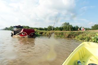 Photo: a heavy-loaded work boat