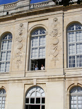 Photo: This building face contains a number of scientific instruments in bas-relief.
