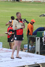 Photo: Ross McRae, with dislocated shoulder, trys to take photos. Photo by Anne-Marie Robb.