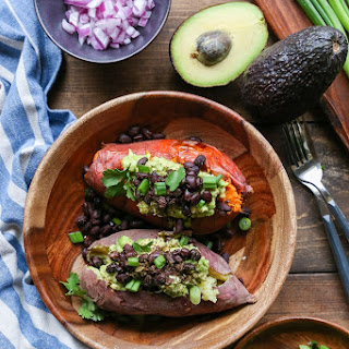 Guacamole and Black Bean Loaded Sweet Potatoes.