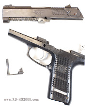 Photo: The slide is now off the pistol with the slide stop removed.