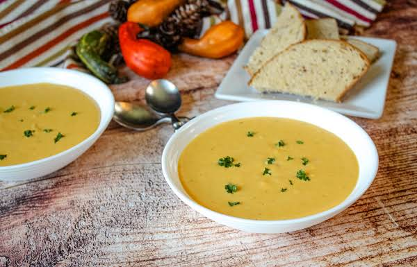 Two Bowls Of Roasted Butternut Squash Soup.