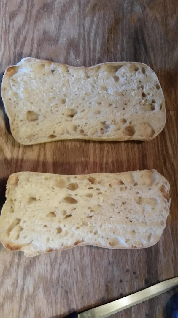 Slice Ciabatta length ways and brush with melted butter. Place under broiler until butter...