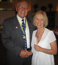 Photo: President Blaine Timmer with Patti Stephens (Executive Director of the Four Townes YMCA), receiving donation from the Rotary Club of DeBary-Deltona on June 5, 2010 at the Annual Installation and Awards Banquet