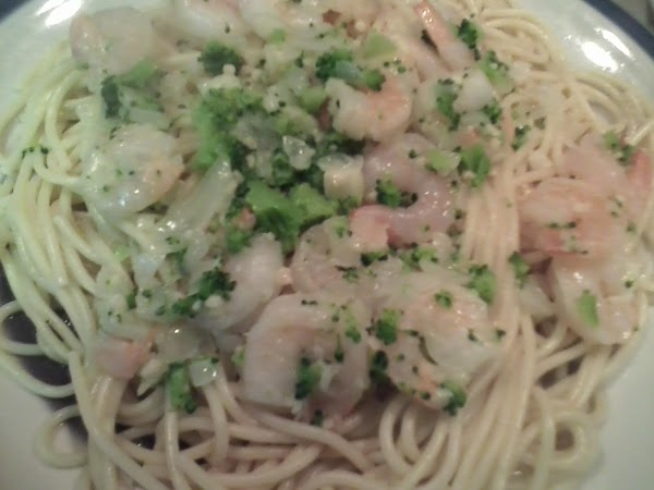 Drain pasta and devide onto two dishes. Top with 1/2 the shrimp and butter...