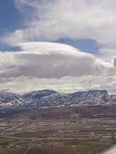 Photo: As we left SLC Friday morning, this very cool lenticular cloud was over the mountains.