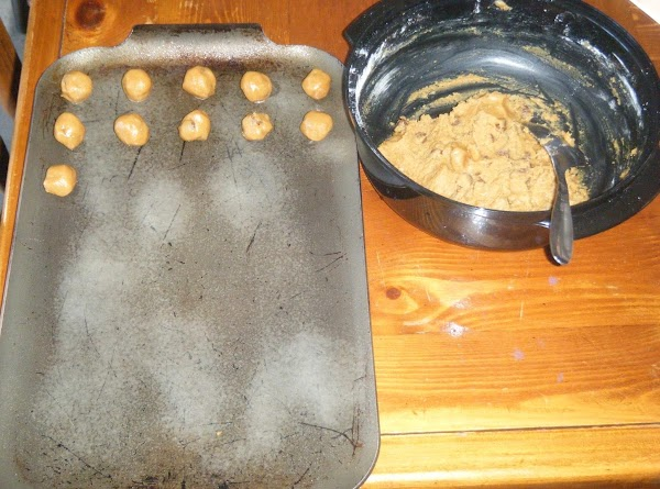 2. Drop cookie dough by rounded tablespoonfuls onto a parchment paper-lined baking sheet. I...