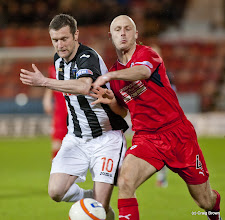 Photo: Dunfermline Athletic v Raith Rovers Irn Bru First Division East End Park 2 January 2013Andy Kirk Battles with Simon Mensing(c) Craig Brown | StockPix.eu
