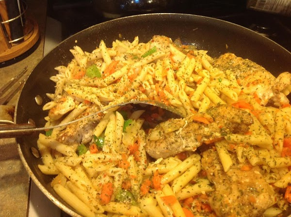 Now add in the pasta, spices, cooked steamed veggies and chicken, stir till blended...