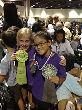 Photo: Allie and Abby Speed Ribbons and Abby's 2nd place medal for Freestyle