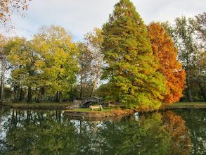 Photo: Stone bridge under autumn trees on a pond at Eastwood Park in Dayton, Ohio.