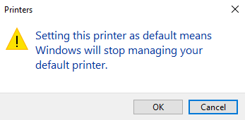 """Printers dialogue box. """"Setting this printer as default means Windows will stop managing your default printer. OK 