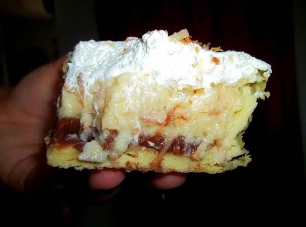 Toasted Coconut Cream Puff Dessert - Delish Recipe