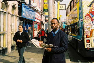 Photo: Man reading The Sun