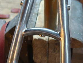 Photo: Curved seat stay bridge with fender boss and rack mounts on the outside of the seat stays.