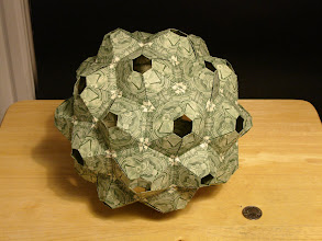 Photo: Model: 90-Unit Truncated Icosahedron;  Creator: Tomoko Fuse;  Folder: William Sattler;  90 dollars total, no glue, the modules fit together using a tab-in-pocket method;  Publication: Unit Polyhedron Origami ISBN 4-88996-205-0