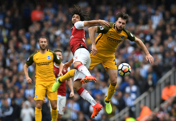 Arsenal's Mohamed Elneny in action with Brighton's Davy Propper at the Emirates Stadium, London on October 1, 2017 Picture: ACTION IMAGES via REUTERS/TONY O'BRIEN